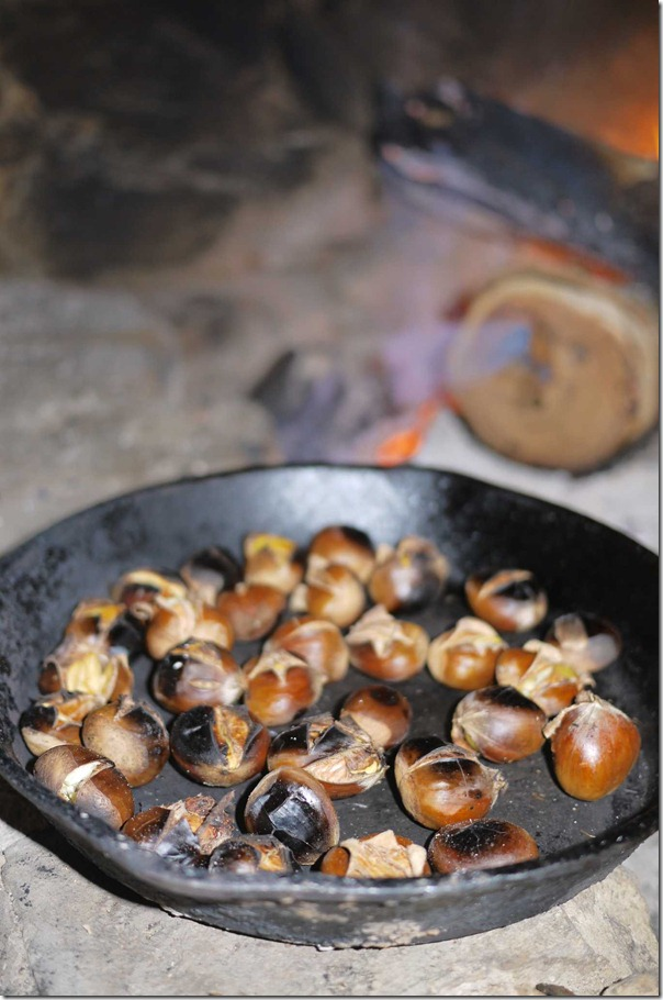 Roasted chestnuts on a cast iron pan