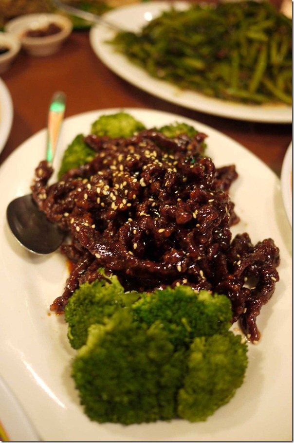 Peking style deep fried beef strips and broccoli