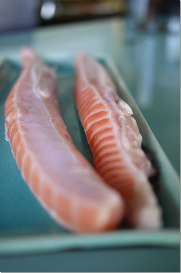 Fresh strips of salmon belly