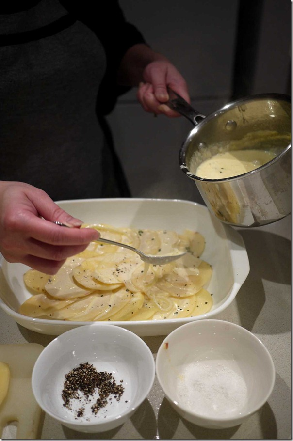 Arrange sliced potato in baking tray and add the butter and cream