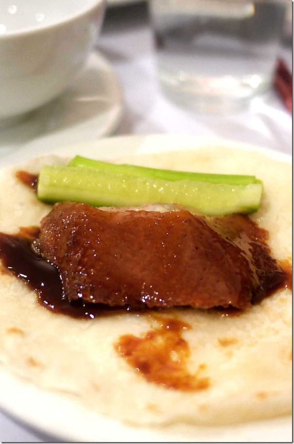 Peking duck with hoisin sauce, cucumber and shallot baton on steamed pancake