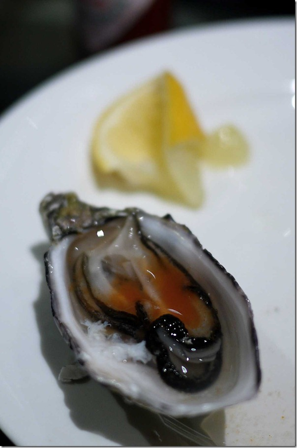 Fresh oyster with a squeeze of lemon juice and Tabasco sauce