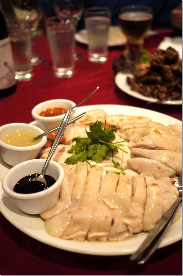 Hainanese style chicken with condiments - chilli sauce, ginger sauce and Kecap Manis