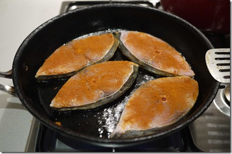 Searing mackerel in hot pan