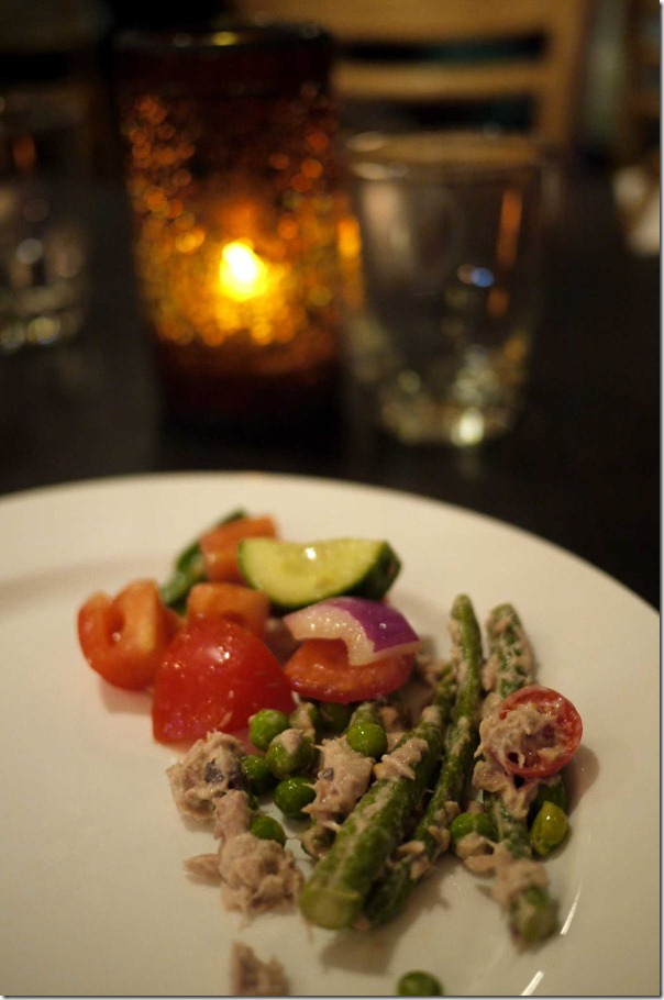 Nicoise salad, French beans with tuna, peas and cherry tomato