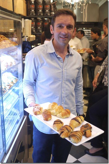 Gus Mendez, Founder of Dulce Luna with a selection of pastries