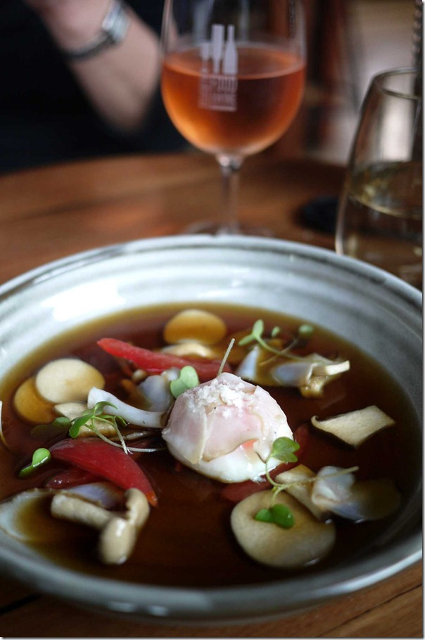 Chicken & mushroom consomme with abalone & 63 degrees C hen's egg $22