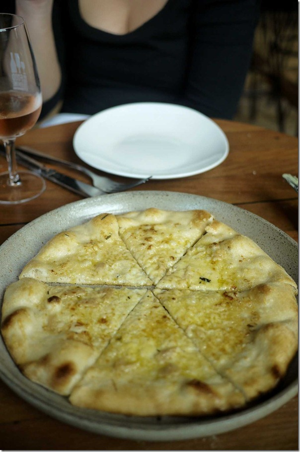 Bianca - pizza with garlic, rosemary & parmesan $15