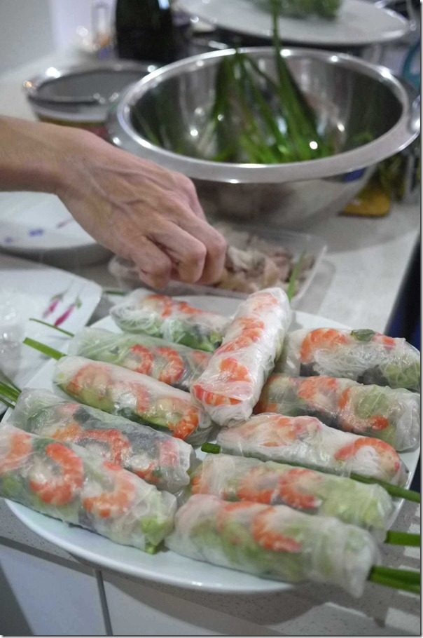 Vietnamese rice paper rolls with prawns, pork belly and garlic chives