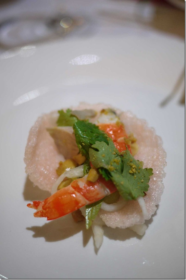 Prawn salad with coriander radish and roasted peanuts in prawn cracker