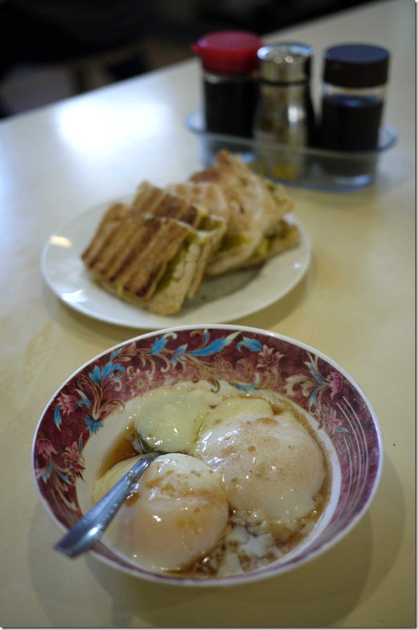Two soft boiled eggs S$1.20 or A$1.00 and kaya toast and butter S$1.60 or A$1.30