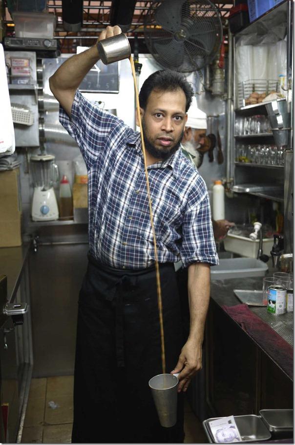Rafee demonstrating his teh tarik pulled tea skills