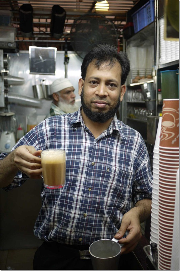 Rafeek with a glass of teh halia ginger tea