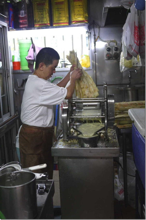 Squeezing out the sugar cane juice