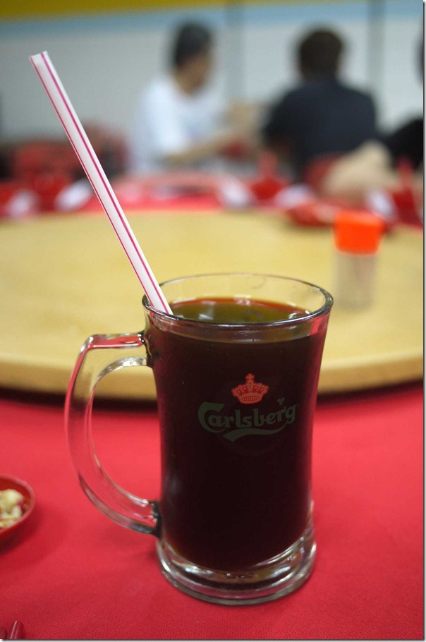 Cooling herbal tea served in a Carlsberg beer mug with a straw RM3 or A$0.90 cents