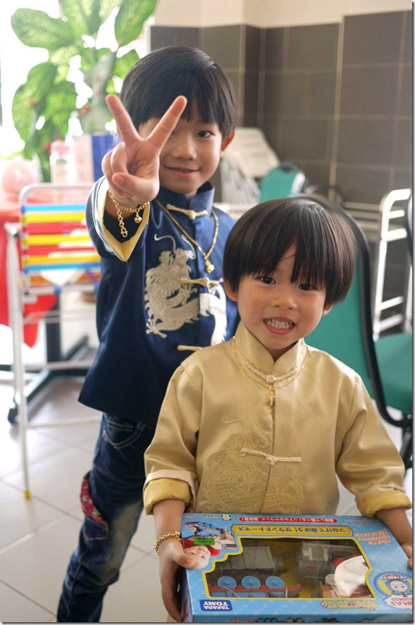 Peace and more toys - JD and Tristan in a happy mood during Chinese New Year 2013