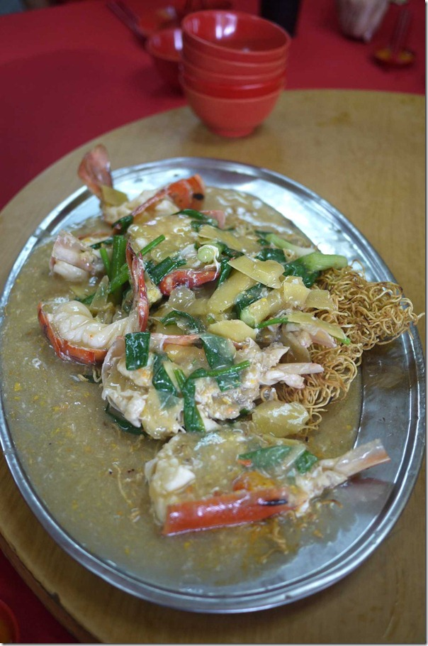 Sang Har Meen or stir-fried fresh water king prawns in ginger & shallots with crispy egg noodles RM120 or A$37
