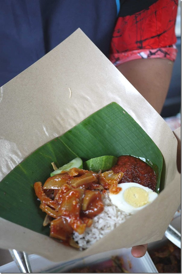Packet nasi lemak with sotong sambal RM2.40 or A$0.75 cents per packet