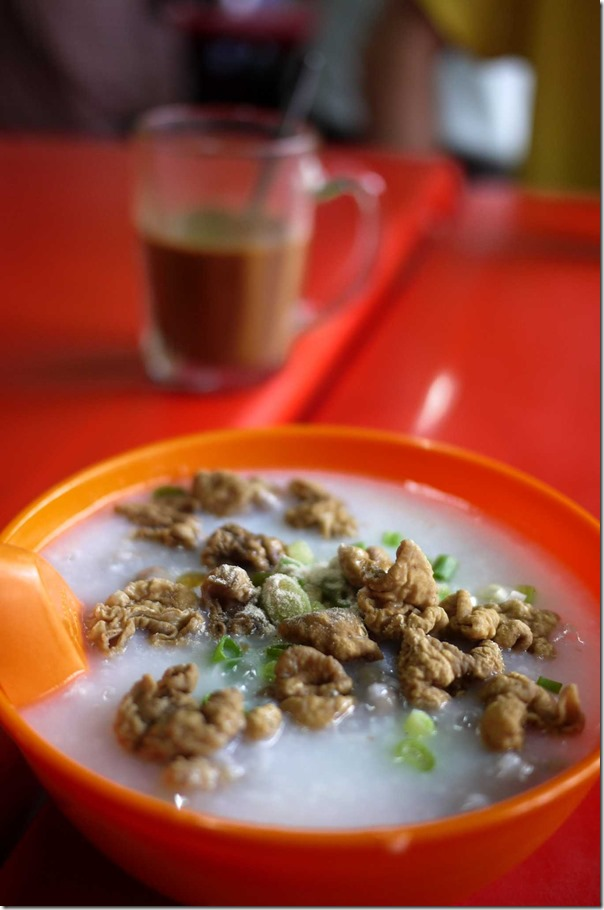 Pork congee topped with deep-fried crispy pork intestines RM5 or A$1.55