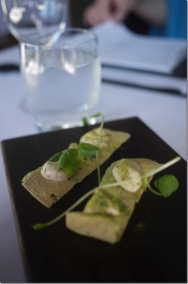 Amuse Bouche ~ Smoked trout mousse and green pea dust on crispy papadam