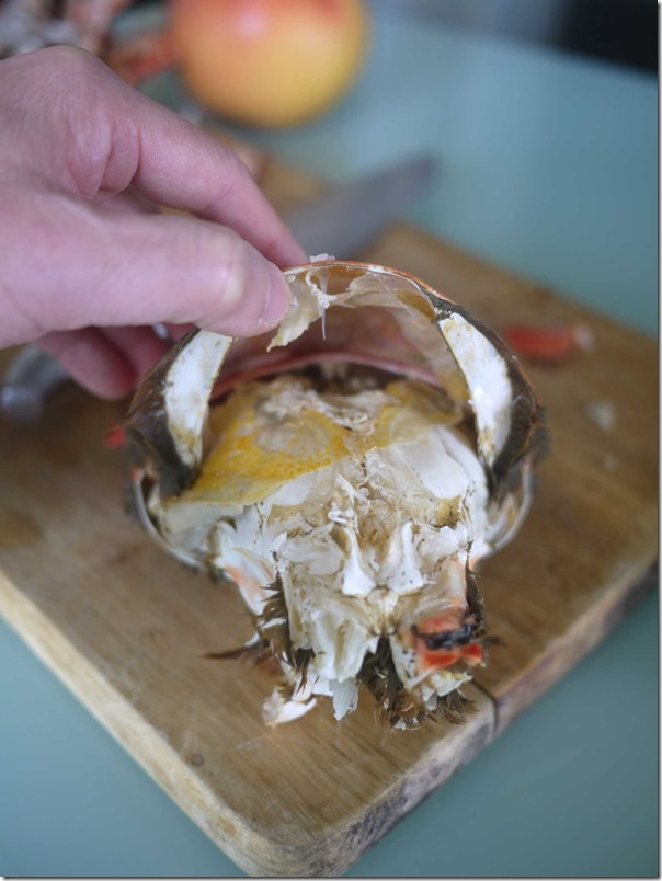 Remove all the crab legs and lift the top shell from the back of the crab