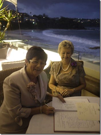 Proud mums: Christine Walker and Dianne Naftzger signing the marriage certificate as witnesses