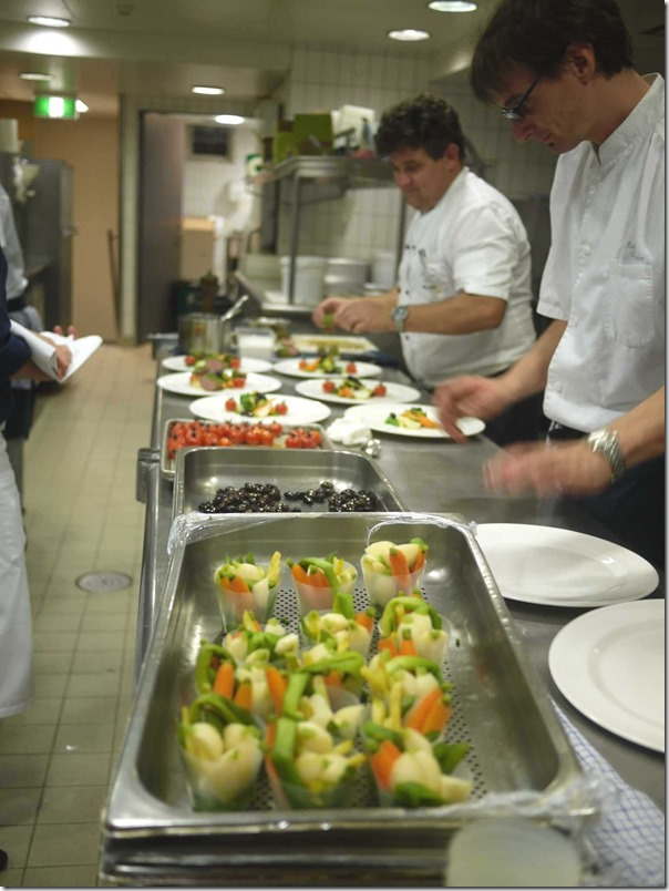 Busy chefs wielding their magic in the kitchen