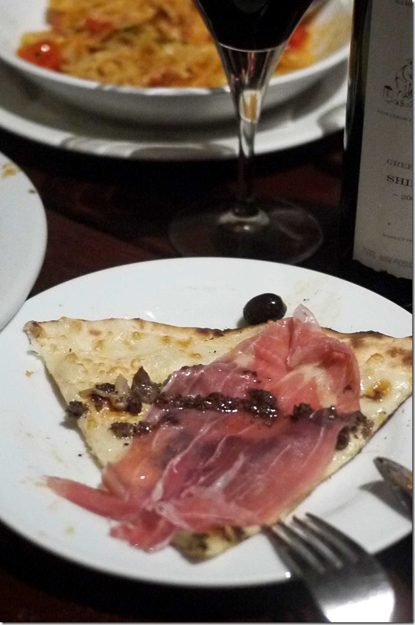 Pizza Tartufa: Mozzarella, prosciutto, wild mushrooms, truffle