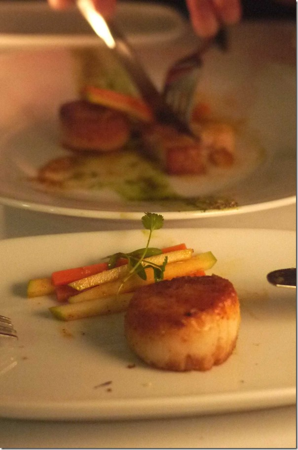 Seared scallops with crispy pork belly, carrot & apple salad