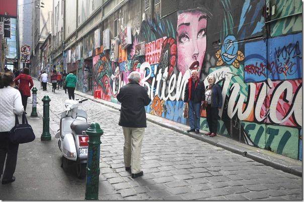 Tourists taking photos with street art at Hosier Lane (off Flinders street), Melbourne