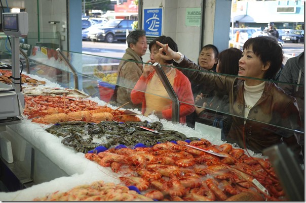 Customers buying seafood at Musumeci Seafoods