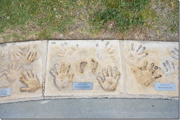 Handprints along a pathway, Cottesloe beach, Perth, Western Australia
