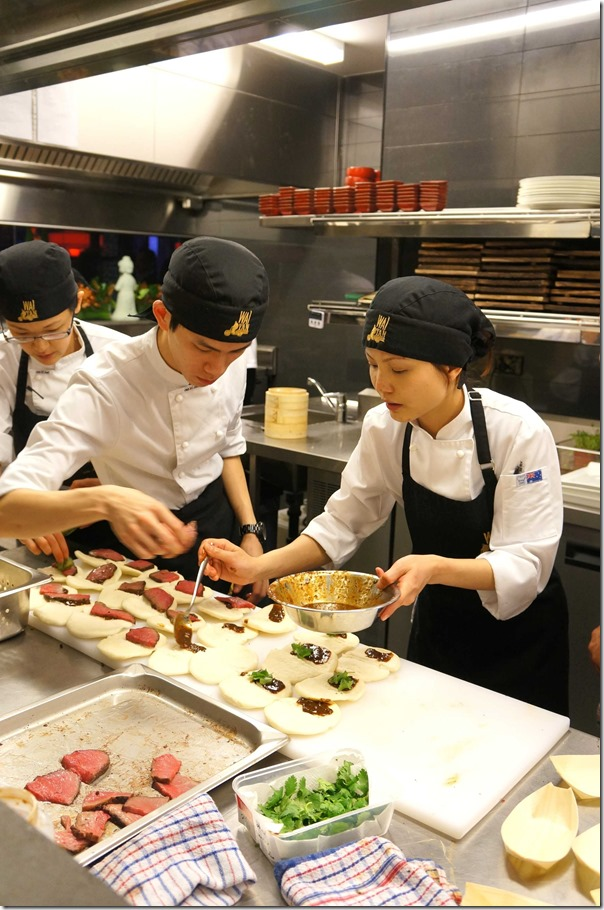 Chefs preparing David Blackmore wagyu beef buns