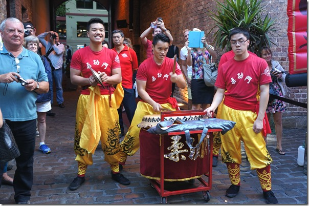 Lion dance troop belting their drums and cymbals