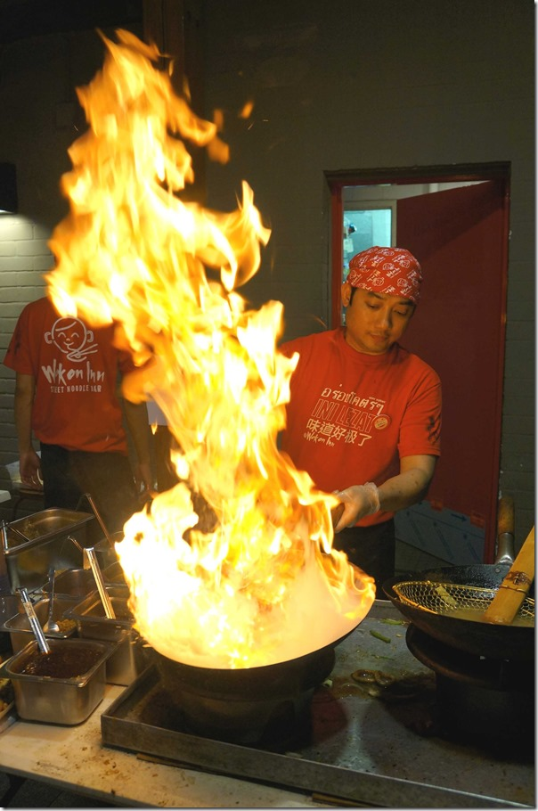 """Now that's what I call flaming the fire"", chef at work"