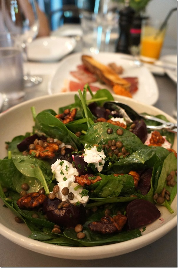 Salad of candied walnuts, baby spinach, goats cheese, beetroot and lentils
