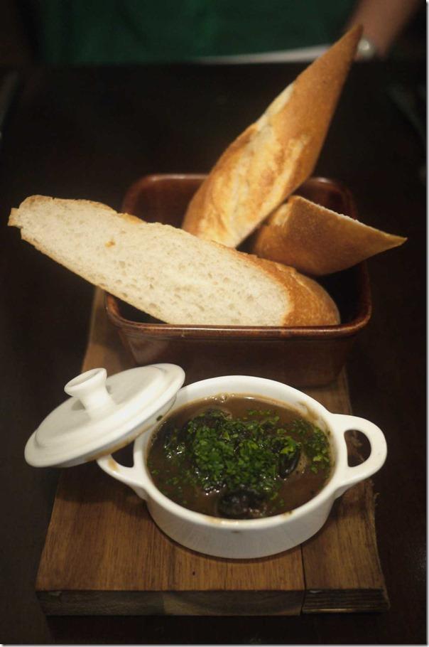 Petite snail casserole Bouguignon with warm baguette $14