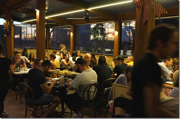 Full house in the outside al fresco dining area fronting Austin street