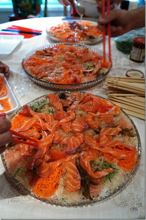 Preparing salmon 'yee sang'