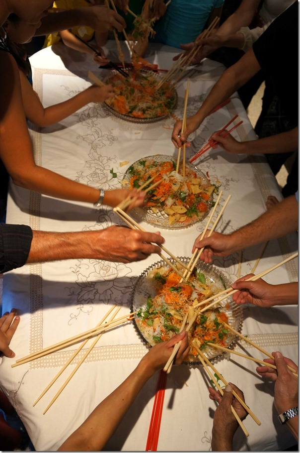 Ushering in the new year ~ tossing 'yee sang'