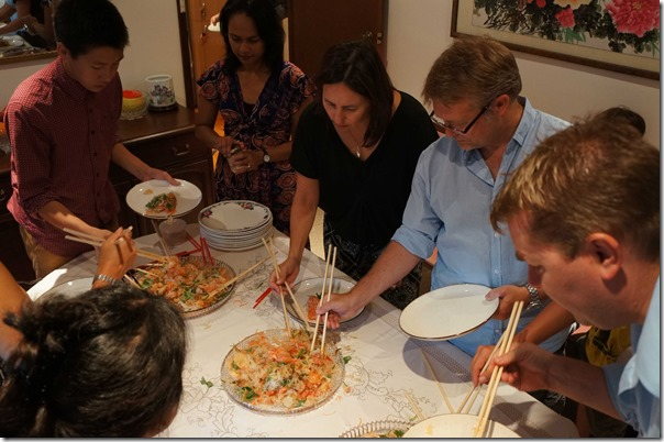 Tucking into 'yee sang' salad