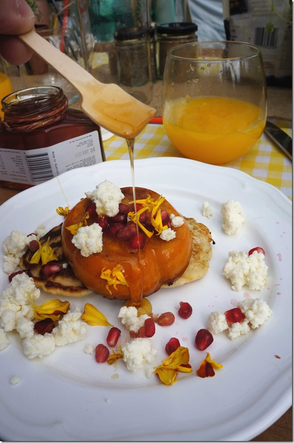 Pancakes with grilled persimmon, pomegranate and maple syrup