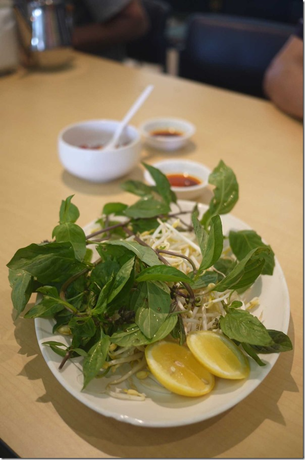 Fresh Vietnamese basil leaves, beansprouts and lemon