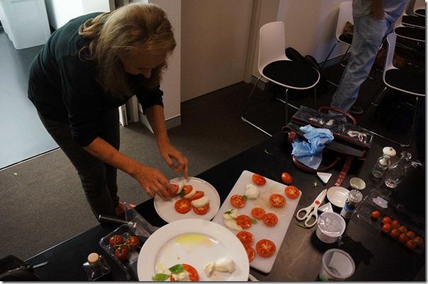 Food stylist Janet plating up a Caprese salad