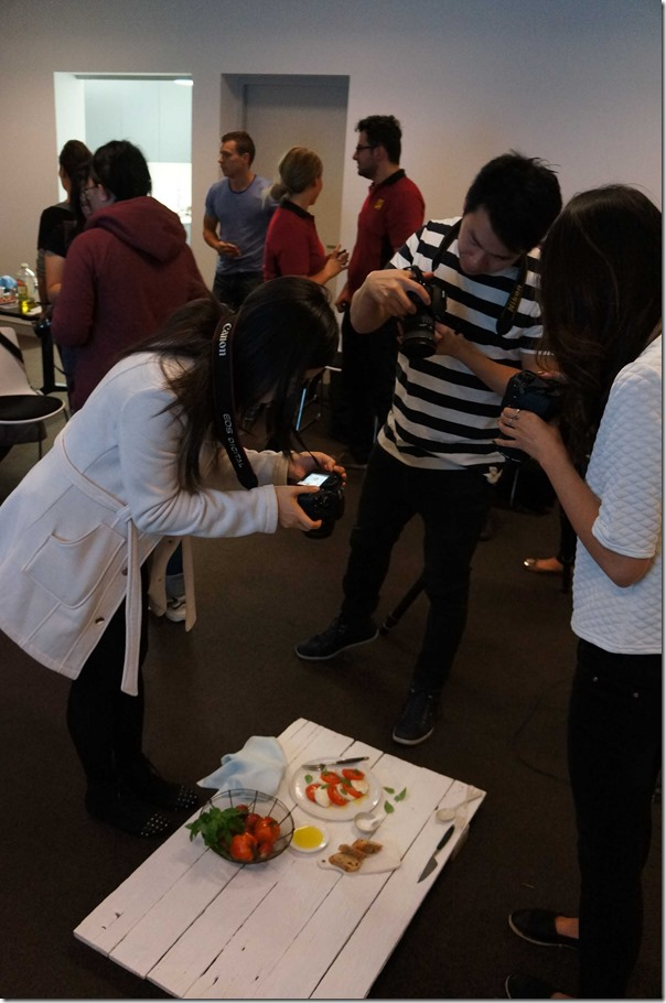 Food bloggers snapping away