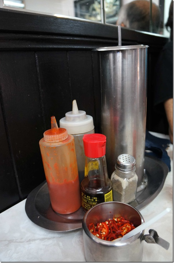 Condiments and chopsticks holder