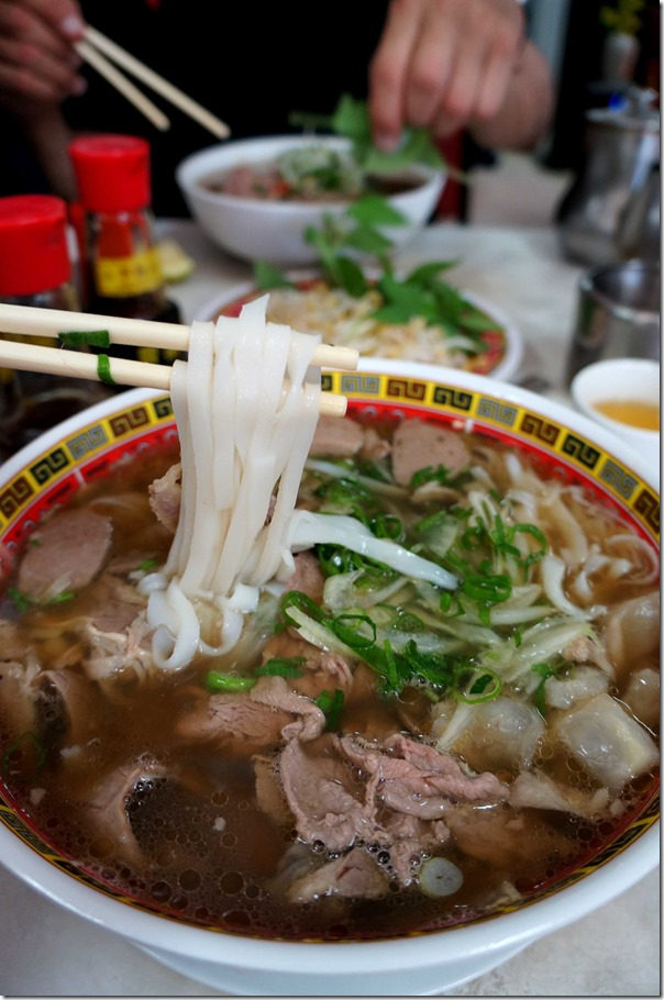 Pho dac biet Special beef pho (large) $14 Pho tai (medium) $11 in background