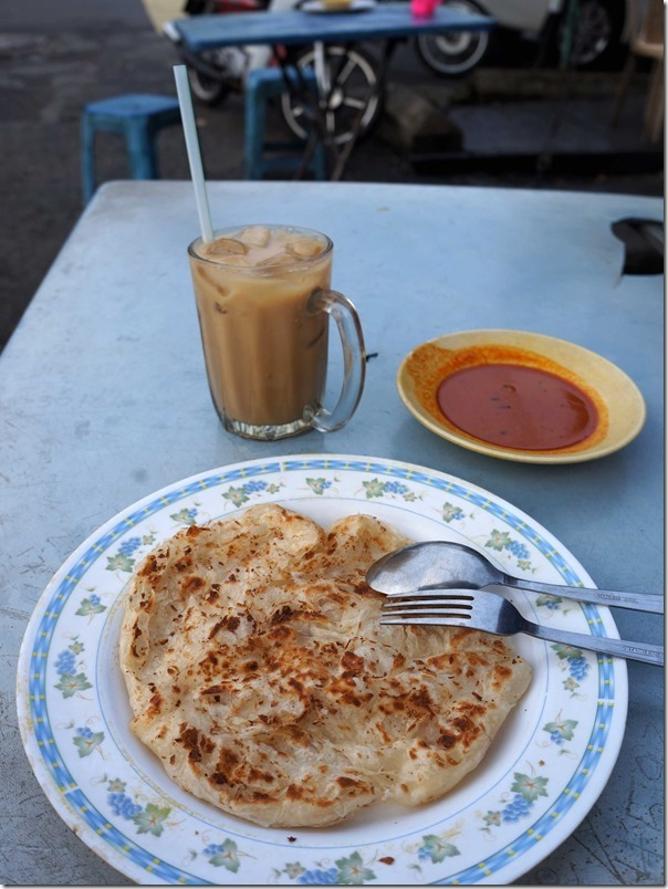 Nescafe ais RM1 or A$0.35, roti canai with fish curry sauce RM1.50 or A$0.52