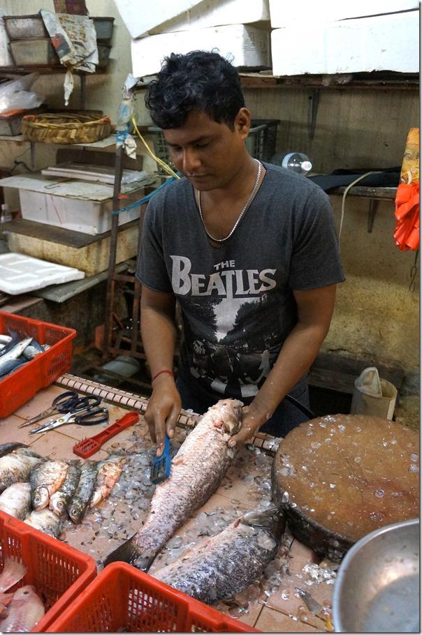 Scaling fish, Petaling Street, Kuala Lumpur