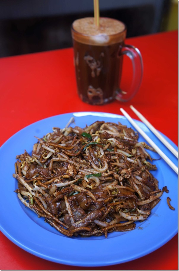 Char Kway Teow RM5 or A$1.70 and Ice coffee RM2.50 or A$0.86 at Jalan Imbi Market, Kuala Lumpur